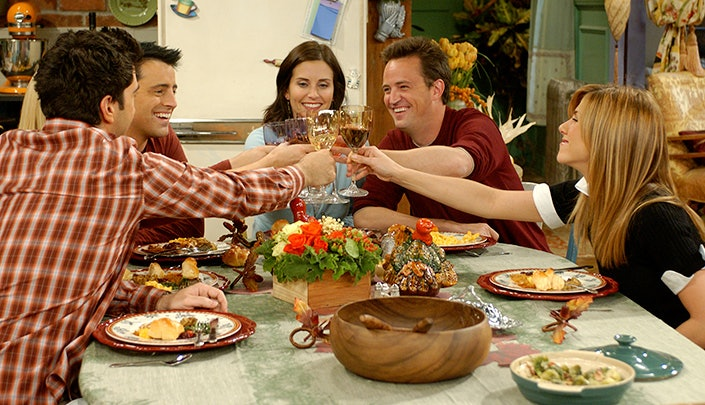 Friends on thanksgiving, Friends, people together for dinner, people enjoying a meal together.