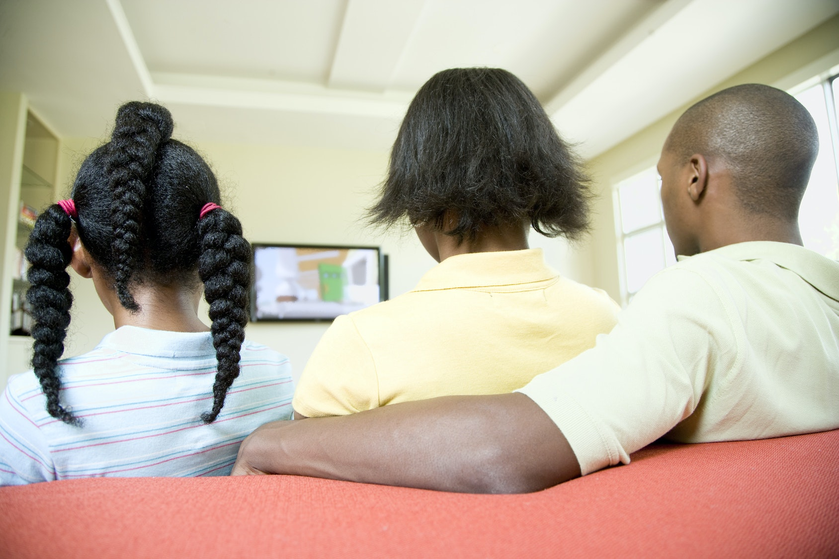 black family watching tv. black family watching tv t