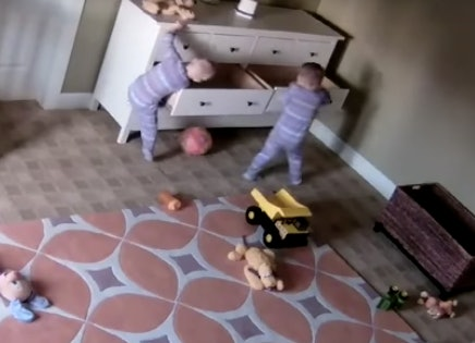 2-year-old moves fallen dresser off of twin brother