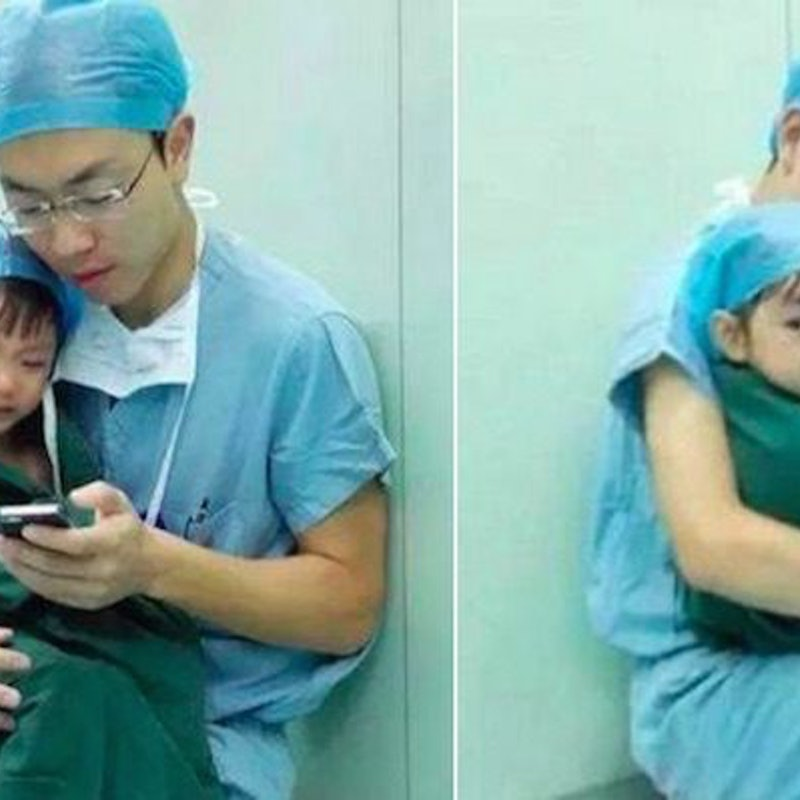Amazing Surgeon Comforts A Little Girl Right Before Her Heart - Surgeon calms crying 2 year old girl about to undergo heart surgery with cartoons on his phone
