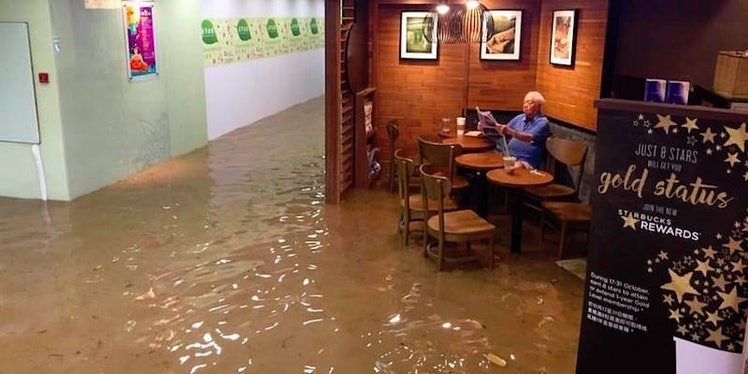 This Starbucks Flooded, But This Man Sat And DGAF