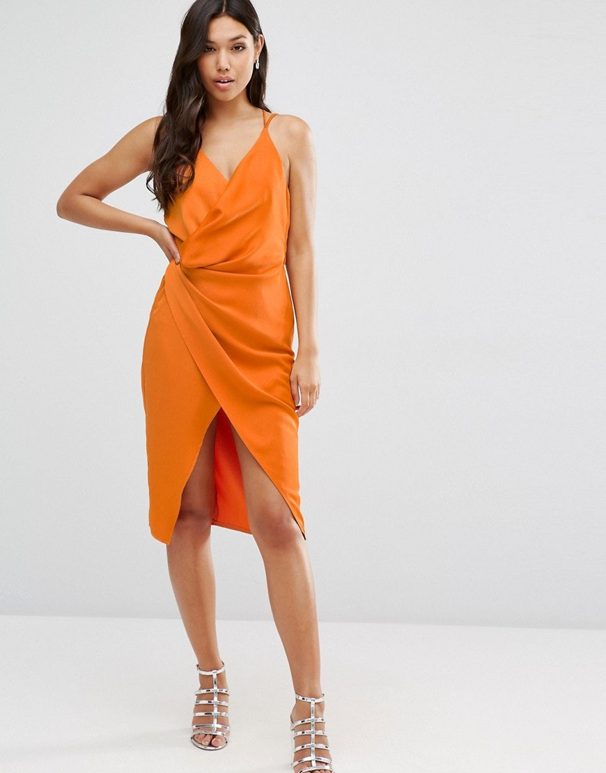 4bccd9025228 Where To Buy Kylie Jenner's Orange Dress From Her Pretty Little Thing Party