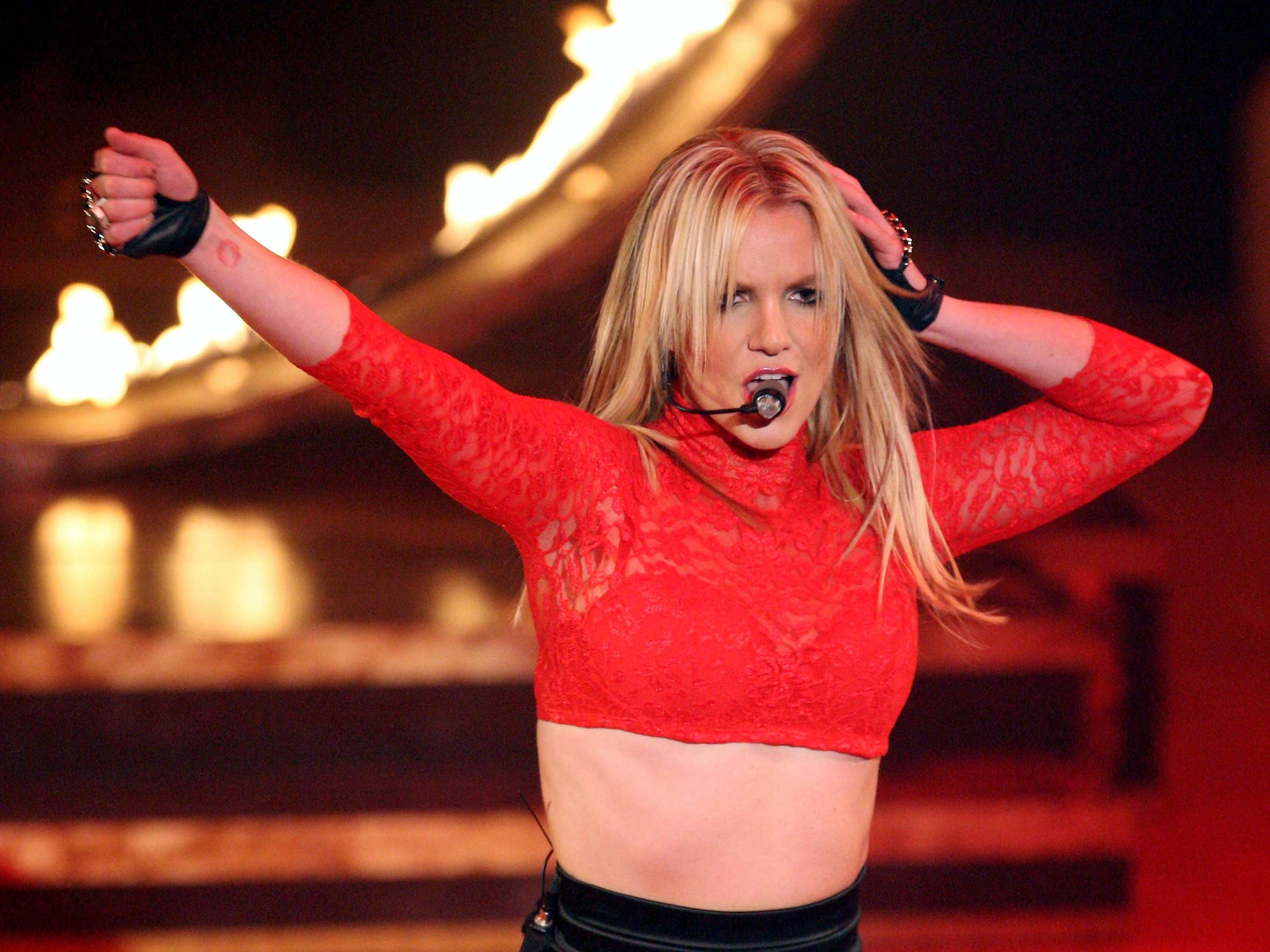 unique britney spears costumes that will immediately transport you back to 2004 this halloween - Britney Spears Red Jumpsuit Halloween Costume