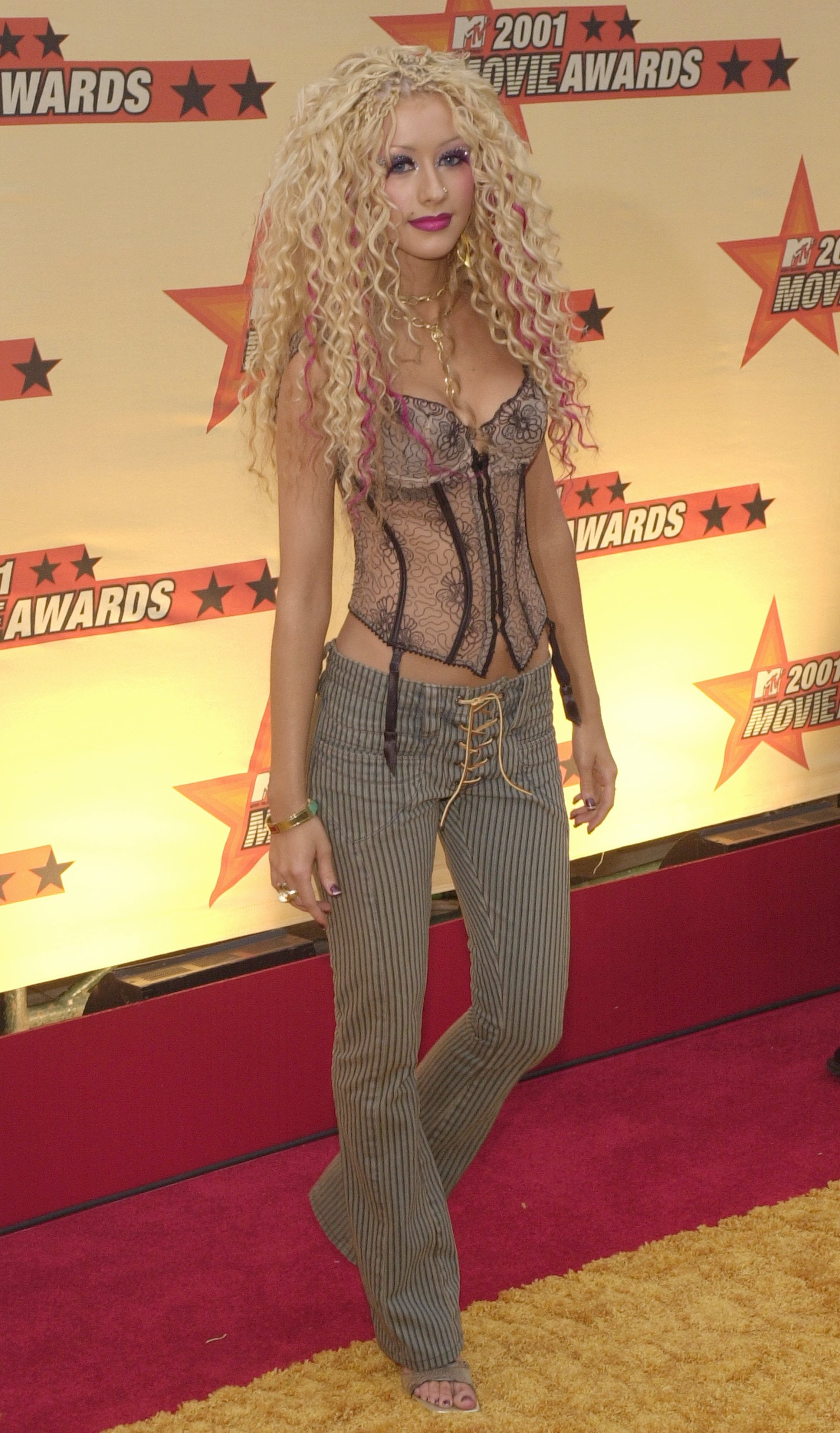 Popular Fashion Trends In 2001 - 40 pop star outfits that defined the 2000s including bikinis as shirts really bad denim and so so many sequins
