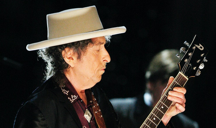 Why did Bob Dylan write protest songs?