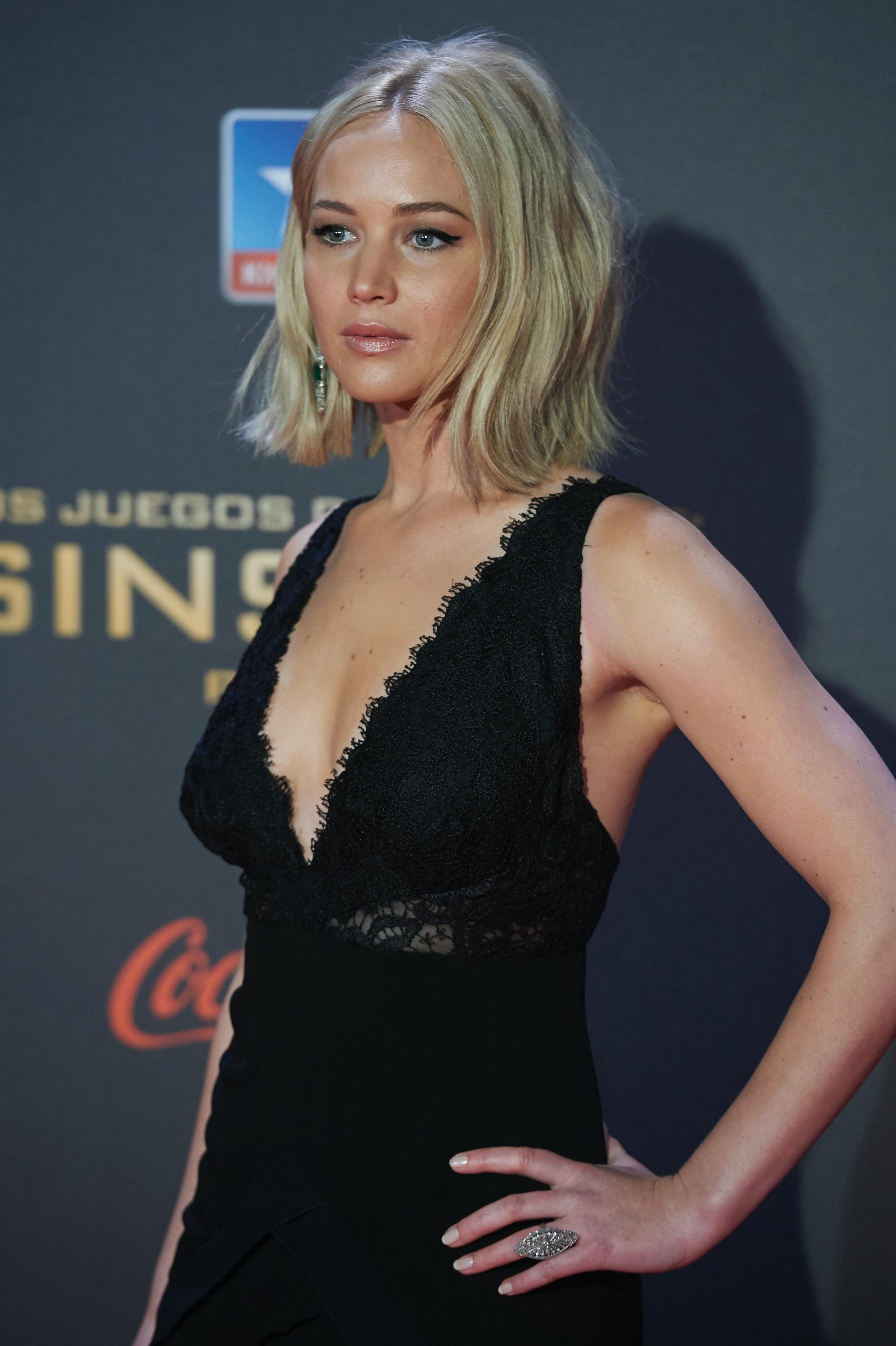 Jennifer Lawrence Wears Black Dress To The Madrid 'Mockingjay ...
