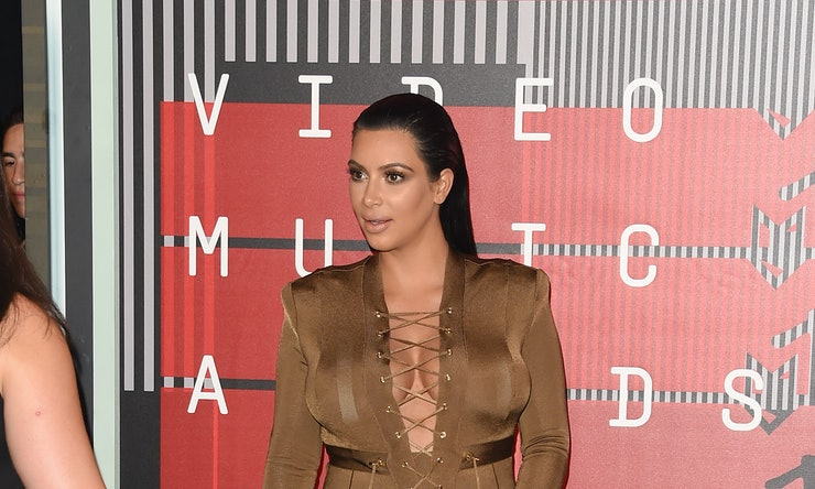 Pregnant Kim Kardashian Sports See-Through Dress After