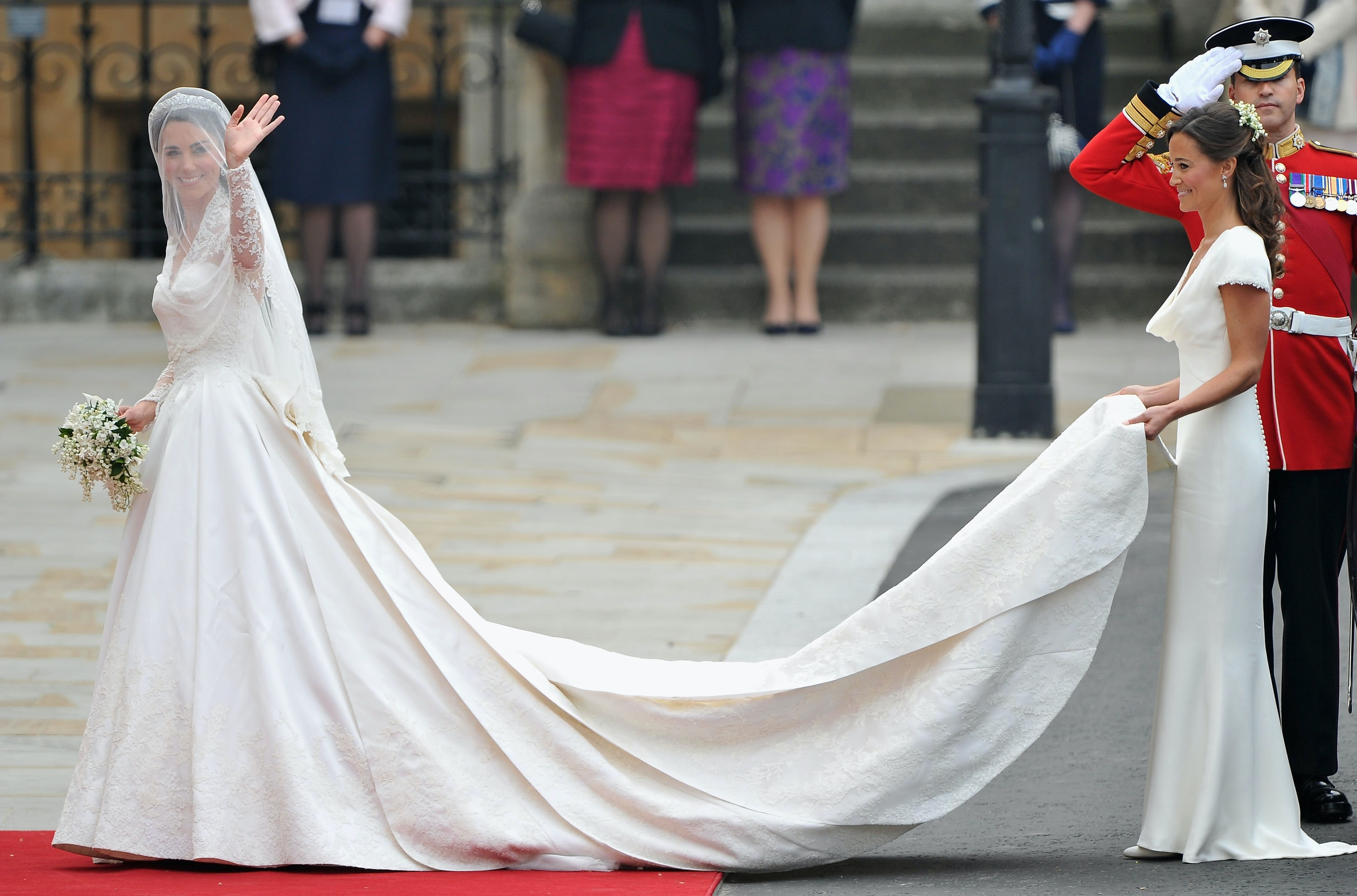 Photos Of Meghan Markles First Wedding Dress Prove She Admires Kate Middletons Style