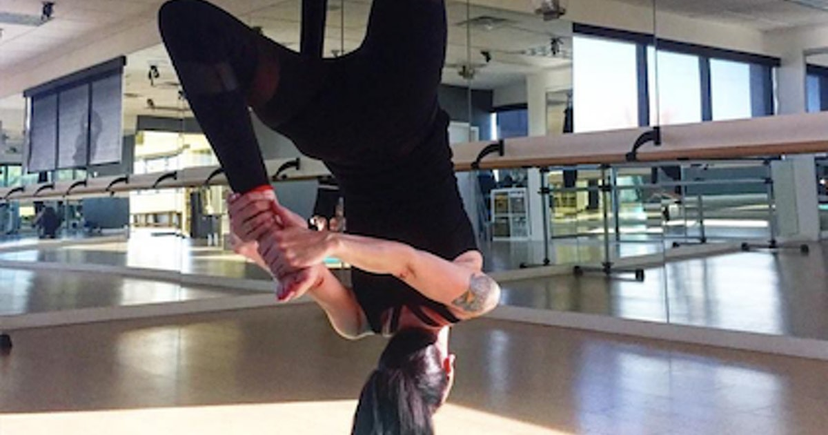 How Aerial Yoga Can Help People Living With Trauma, Chronic Pain, & Other Conditions Heal