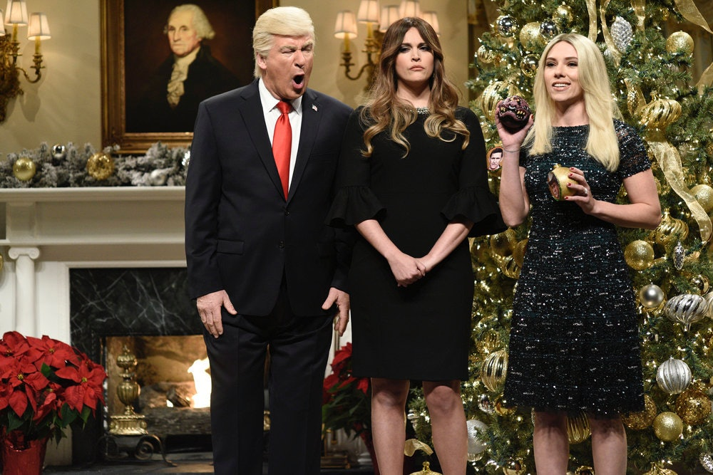 Ribbing around the Christmas tree as Scarlett Johansso plays Ivanka