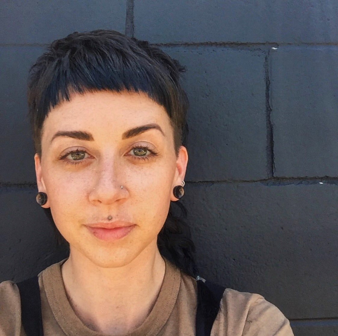 7 queer folks on their haircuts & why they mean so damn much